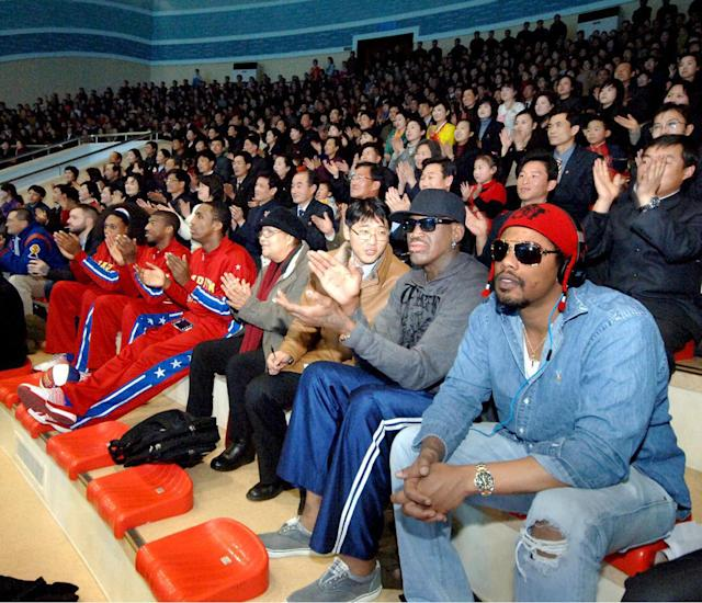 "In this image released by the Korean Central News Agency (KCNA) and distributed by the Korea News Service, former NBA star Dennis Rodman, second right in front row, visits a dolphin aquarium in Pyongyang in North Korea Friday, March 1, 2013. Ending his unexpected round of basketball diplomacy in North Korea on Friday, Rodman called leader Kim Jong Un an ""awesome guy"" and said his father and grandfather were ""great leaders."" (AP Photo/KCNA via KNS) JAPAN OUT UNTIL 14 DAYS AFTER THE DAY OF TRANSMISSION"