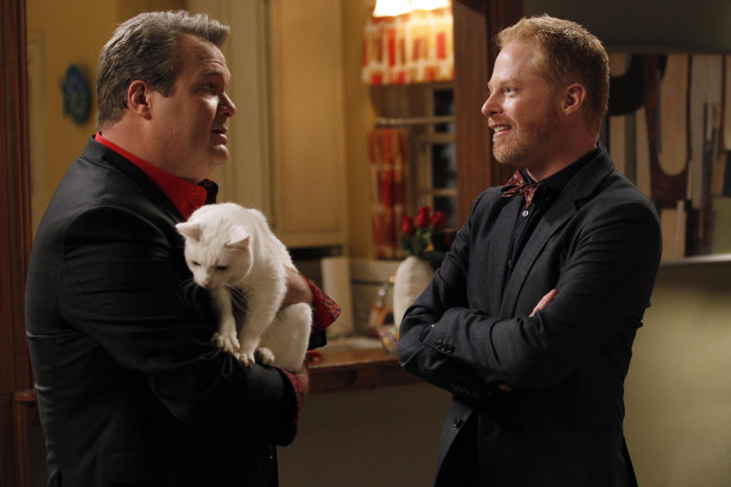 """This image released by ABC shows Eric Stonestreet, left, and Jesse Tyler Ferguson in a scne from """"Modern Family."""" (AP Photo/ABC, Peter """"Hopper"""" Stone)"""