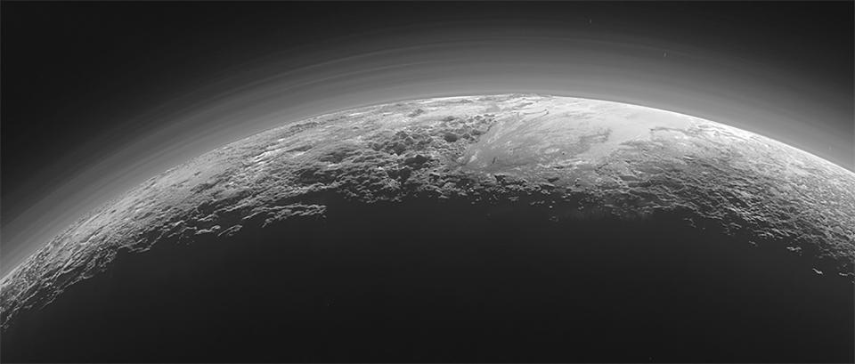 A near-sunset view of the rugged, icy mountains and flat ice plains on Pluto taken by New Horizons. (Reuters)