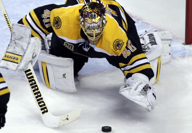 Boston Bruins goalie Tuukka Rask pounces on a loose puck against the Montreal Canadiens during the second period of Game 2 in the second-round of the Stanley Cup hockey playoff series in Boston, Saturday, May 3, 2014. (AP Photo/Charles Krupa)