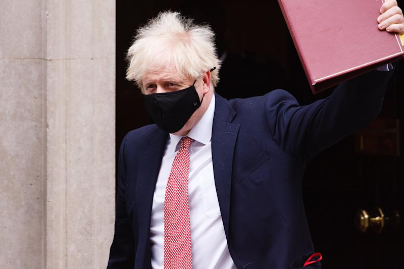 British Prime Minister Boris Johnson leaves 10 Downing Street wearing a face mask, heading for Prime Minister's Questions (PMQs) at the House of Commons in London, England, on October 7, 2020. (Photo by David Cliff/NurPhoto via Getty Images)