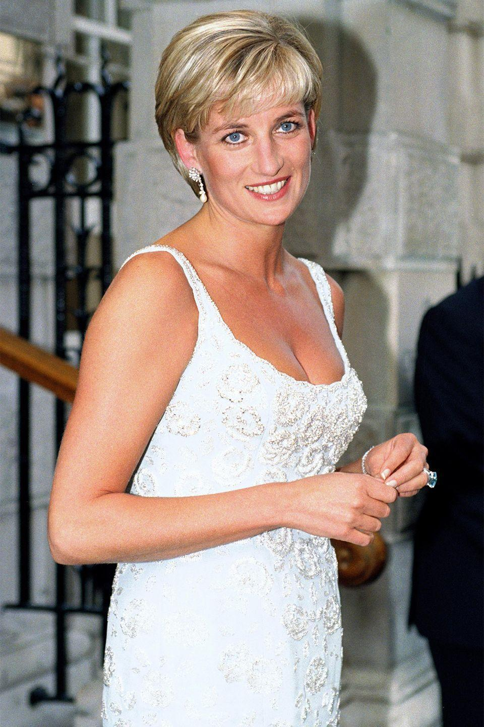 <p>At a gala for the preview of a dress auction she was holding at Christies in London. </p>