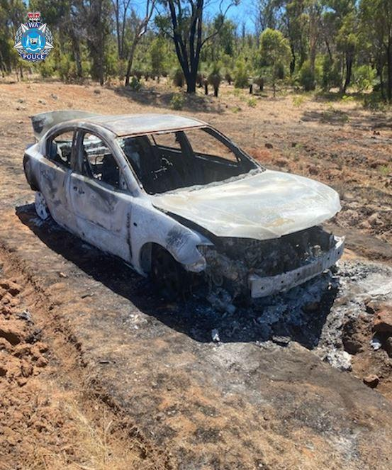 Mr Nguyen's burnt out blue Mazda 3 sedan was found nearby. Source: WA Police