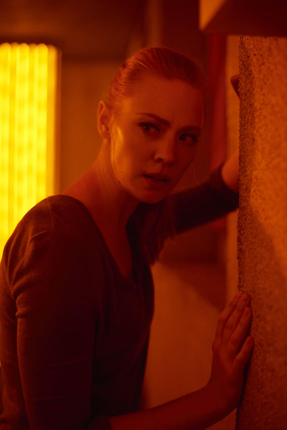 """This image released by Sony Pictures shows Deborah Ann Woll in """"Escape Room."""" (David Bloom/Sony Pictures via AP)"""