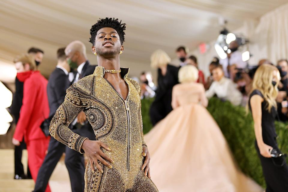 """<ul> <li><strong>What to wear: </strong>Lil Nas X showed up to the Met Gala looking <em>fierce</em>. First wearing a billowing champagne-colored cape then quickly transitioning into a gold suit of armor - but it doesn't stop there! Lil Nas completed his red carpet attire with a beaded bodysuit that zipped up the front, and truly, this may be the best look to replicate for <a class=""""link rapid-noclick-resp"""" href=""""https://www.popsugar.com/Halloween"""" rel=""""nofollow noopener"""" target=""""_blank"""" data-ylk=""""slk:Halloween"""">Halloween</a> - stylish and comfortable!</li> </ul>"""