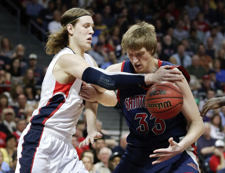 Gonzaga's Kelly Olynyk, left, tries to strip the ball from Saint Mary's Matt Hodgson during the first half of the West Coast Conference tournament championship NCAA college basketball game, Monday, March 11, 2013, in Las Vegas. (AP Photo/Julie Jacobson)