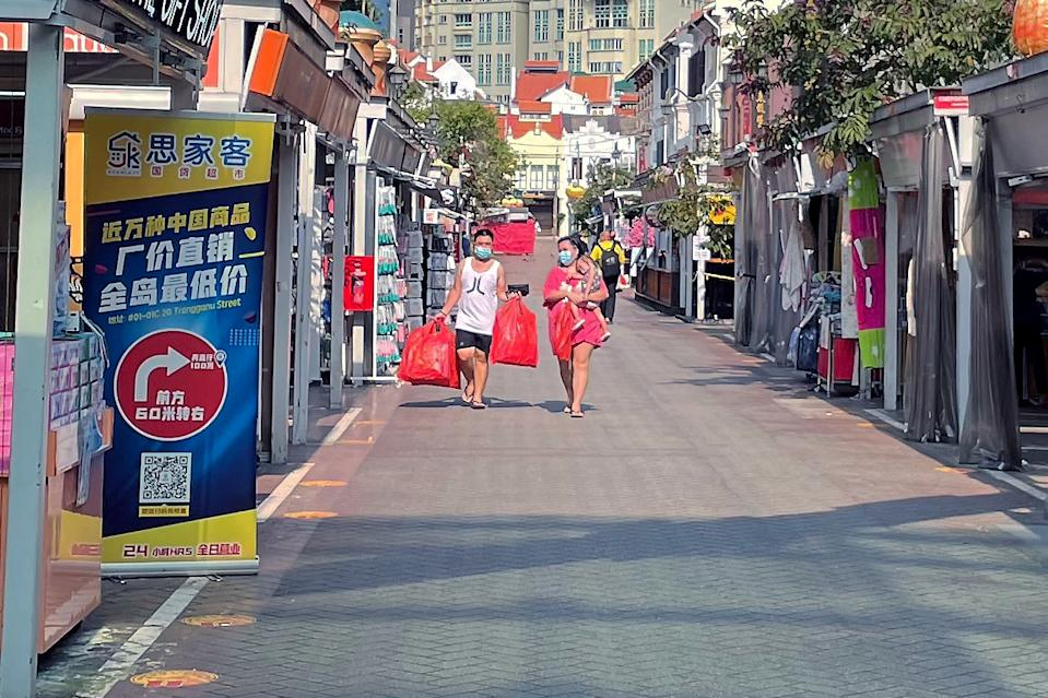 People seen in the Chinatown area on 24 May 2021, amid Singapore's Phase 2 (Heightened Measures) period. (PHOTO: Dhany Osman / Yahoo News Singapore)