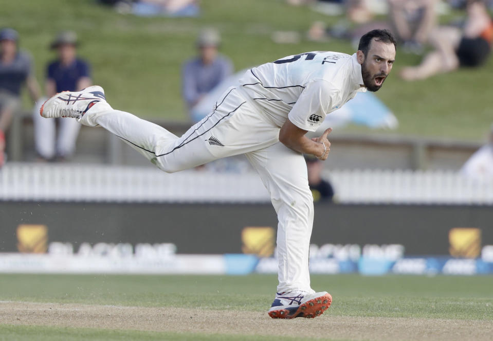 FILE - In this Nov. 30, 2019 file photo,New Zealand's Daryl Mitchell bowls during play on day two of the second cricket test between England and New Zealand at Seddon Park in Hamilton, New Zealand. Mitchell have been included for the first time on New Zealand Cricket's list of centrally contracted players. (AP Photo/Mark Baker,File)