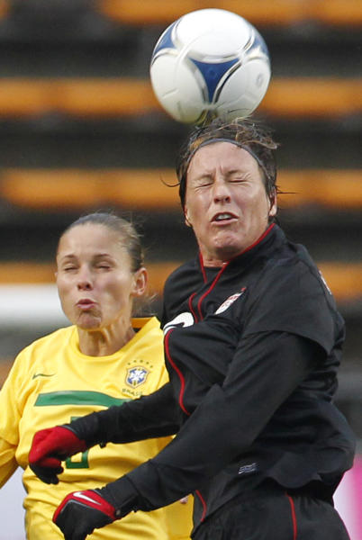 Abby Wambach of the United States, right, and Erika Cristiano dos Santos battle for the ball during their Kirin Challenge Cup women's friendly soccer match in Chiba, Tuesday, April 3, 2012. (AP Photo/Koji Sasahara)