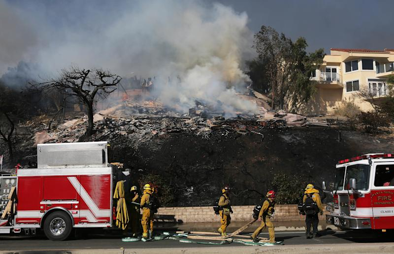Firefighters were struggling to contain the blaze, which had burned more than 50,000 acres by Tuesday afternoon. (Mario Tama via Getty Images)