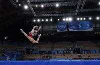Angelina Melnikova, of the Russian Olympic Committee, performs her floor exercise during the women's artistic gymnastic qualifications at the 2020 Summer Olympics, Sunday, July 25, 2021, in Tokyo. (AP Photo/Ashley Landis)