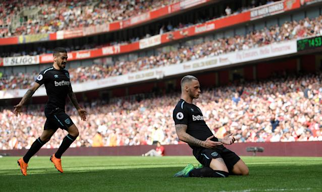 """Soccer Football - Premier League - Arsenal v West Ham United - Emirates Stadium, London, Britain - April 22, 2018 West Ham United's Marko Arnautovic celebrates scoring their first goal REUTERS/Toby Melville EDITORIAL USE ONLY. No use with unauthorized audio, video, data, fixture lists, club/league logos or """"live"""" services. Online in-match use limited to 75 images, no video emulation. No use in betting, games or single club/league/player publications. Please contact your account representative for further details."""