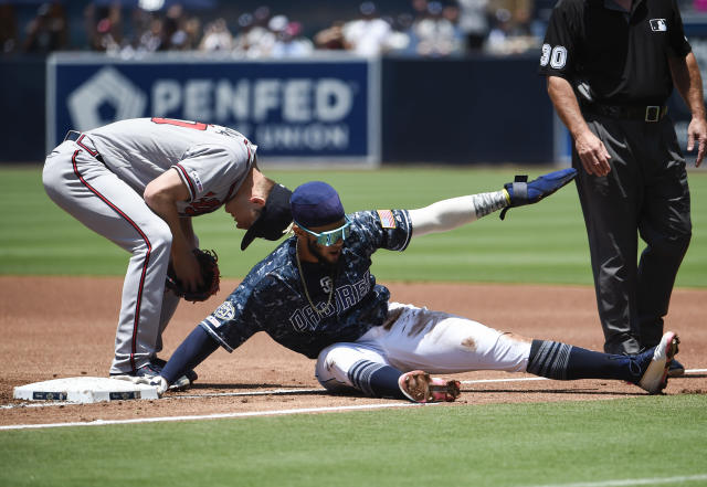 Padres rookie shortstop Fernando Tatis Jr. got back to first on an acrobatic slide. (Photo by Denis Poroy/Getty Images)