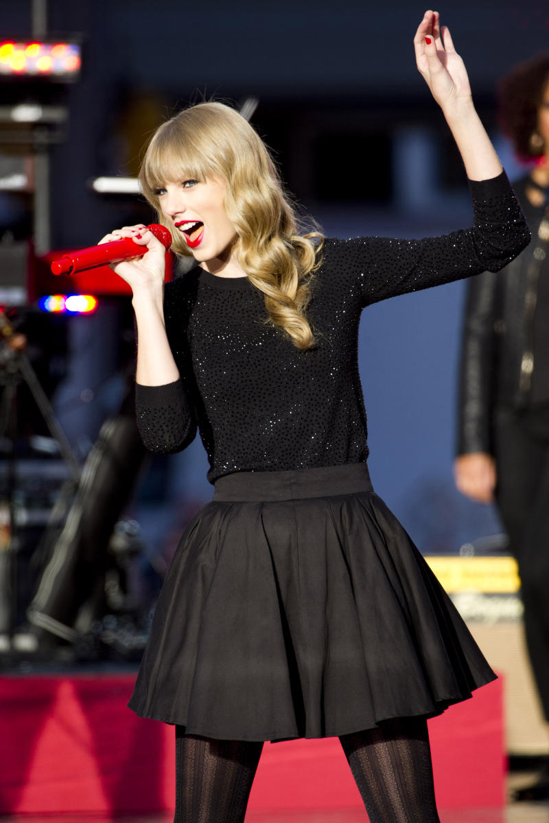 """FILE - In this Tues., Oct. 23, 2012 file photo, Taylor Swift performs on ABC's """"Good Morning America,"""" in New York. Brad Paisley and Carrie Underwood co-host the CMA awards show on Thursday, Nov. 1, 2012, at 8 p.m. EDT, live on ABC from the Bridgestone Arena in Nashville. From Taylor Swift's army of empowered young women to the power-drinking party boys who prefer Church and Jason Aldean, country's audience is much different than it was 10 years ago and that's reflected in the awards. (Photo by Charles Sykes/Invision/AP, File)"""