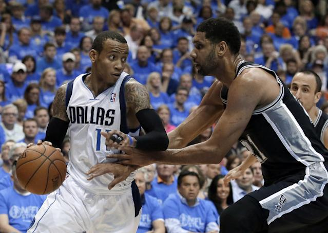 Dallas Mavericks' Monta Ellis (11) looks for an opening to the basket as San Antonio Spurs' Tim Duncan defends in the first half of Game 4 of an NBA basketball first-round playoff series, Monday, April 28, 2014, in Dallas. (AP Photo/Tony Gutierrez)