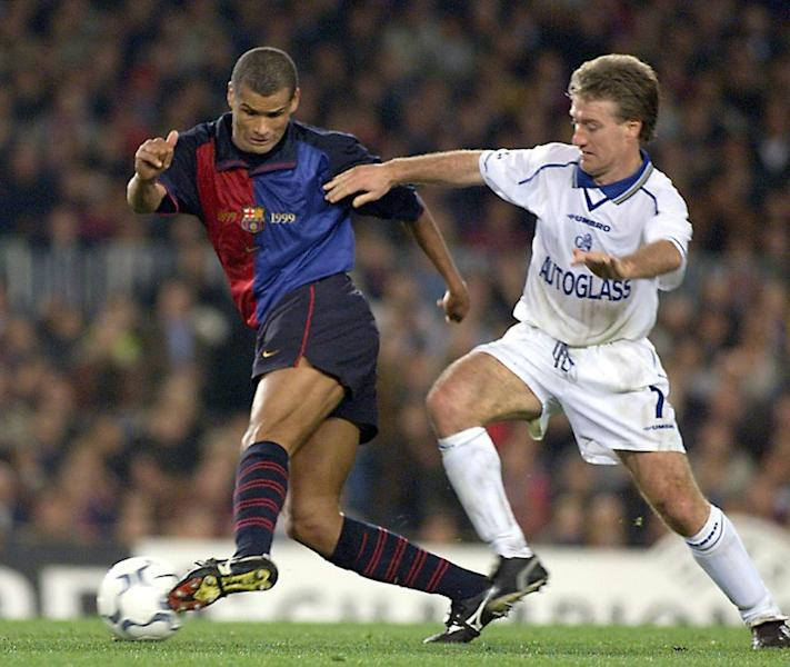 Barcelona's Rivaldo (L) keeps the ball from Didier Deschamps of Chelsea in April 2000