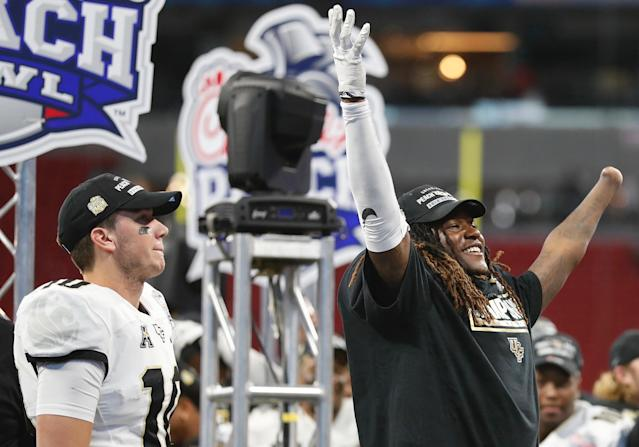 UCF's one-handed All-AAC linebacker Shaquem Griffin celebrates the Peach Bowl win with QB McKenzie Milton. (AP)