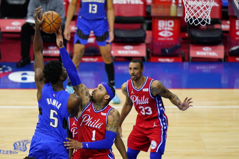 Orlando Magic's Mo Bamba, left, cannot get a shot past Philadelphia 76ers' Mike Scott during the second half of an NBA basketball game, Friday, May 14, 2021, in Philadelphia. (AP Photo/Matt Slocum)