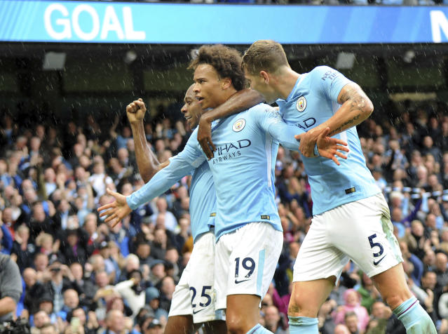 Leroy Sane, Fernandinho and John Stones celebrate City's fifth goal