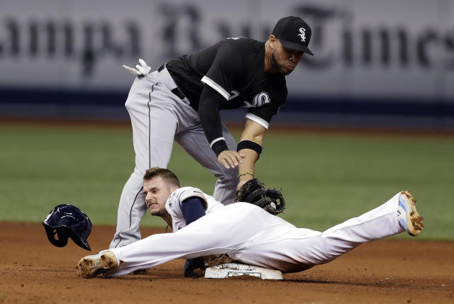 Tampa Bay Rays' Daniel Robertson slides into second base with a double ahead of the tag by Chicago White Sox second baseman Yoan Moncada during the eighth inning of a baseball game Friday, Aug. 3, 2018, in St. Petersburg, Fla. (AP Photo/Chris O'Meara)