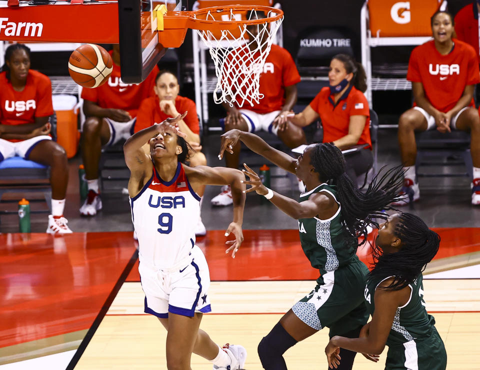 Nigeria guard Ifunanya Ibekwe, center right, blocks a shot from United States forward A'Ja Wilson (9) during the first half of a pre-Olympic exhibition basketball game in Las Vegas on Sunday, July 18, 2021. (Chase Stevens/Las Vegas Review-Journal via AP)