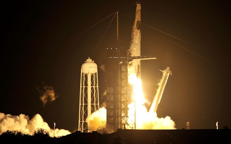 SpaceX launches four astronauts to space station in new era for Nasa