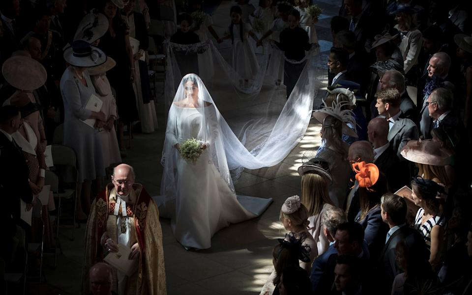 Meghan Markle walks down the aisle as she arrives in St George's Chapel at Windsor Castle for her wedding to Prince Harry in Windsor, Britain, May 19, 2018. Danny Lawson/Pool via REUTERS
