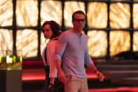 """This image released by Disney shows Jodie Comer as Molotov Girl, left, and Ryan Reynolds as Guy in a scene from """"Free Guy."""" (Alan Markfield/Disney-Twentieth Century Fox via AP)"""