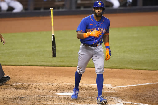 FILE - New York Mets' Amed Rosario tosses his bat after hitting a solo home run during the seventh inning of a baseball game against the Miami Marlins in Miami, in this Tuesday, Aug. 18, 2020, file photo. The Cleveland Indians have traded four-time All-Star shortstop Francisco Lindor and pitcher Carlos Carrasco to the New York Mets, Thursday, Jan. 7, 2021. Cleveland obtained infielders Andres Gimenez and Amed Rosario, right-hander Josh Wolf and outfielder Isaiah Greene. (AP Photo/Lynne Sladky, File)