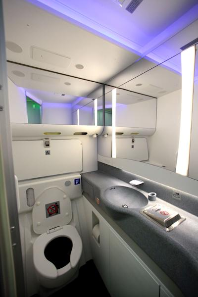 A restroom is seen with some of the variable lighting available on the new Boeing 747-8 Intercontinental before delivery by Boeing to Lufthansa Tuesday, May 1, 2012, in Everett, Wash. Lufthansa is the launch customer for the Intercontinental and will start service with the airplane between Frankfurt, Germany and Washington, D.C. The 747-8 Intercontinental is a stretched, updated version of the iconic 747 and is expected to bring double-digit improvements in fuel burn and emissions over its predecessor, the 747-400, and generate 30 percent less noise. Boeing delivered the first 747-8 Intercontinental to a private customer in February, more than a year after originally planned. (AP Photo/Elaine Thompson)