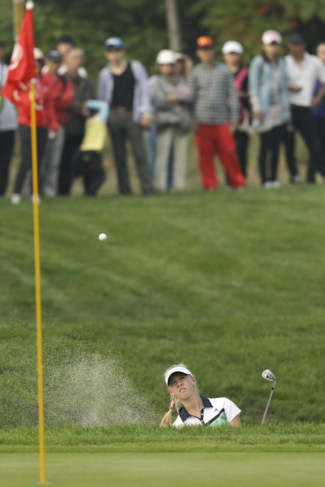 Jessica Korda of the United States hits out of a bunker on the 15th hole during the second round of the Reignwood LPGA Classic golf tournament at Pine Valley Golf Club on the outskirts of Beijing, China, Friday, Oct. 4, 2013. (AP Photo/Alexander F. Yuan)