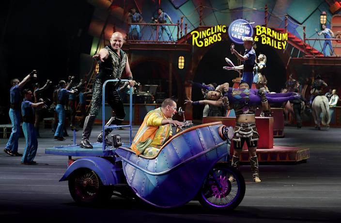 """Ringling Bros. and Barnum & Bailey performers begin a show Saturday, Jan. 14, 2017, in Orlando, Fla. The Ringling Bros. and Barnum & Bailey Circus will end the """"The Greatest Show on Earth"""" in May, following a 146-year run of performances. Kenneth Feld, the chairman and CEO of Feld Entertainment, which owns the circus, told The Associated Press, declining attendance combined with high operating costs are among the reasons for closing. (AP Photo/Chris O'Meara)"""