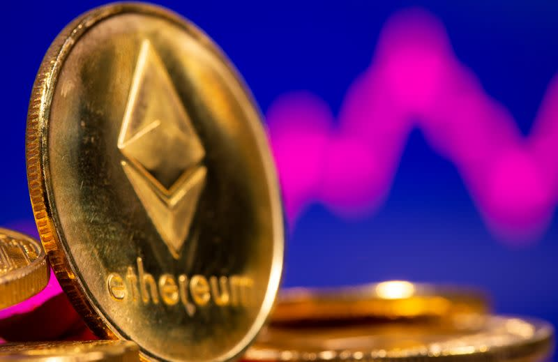 A representation of virtual currency Ethereum are seen in front of a stock graph in this illustration