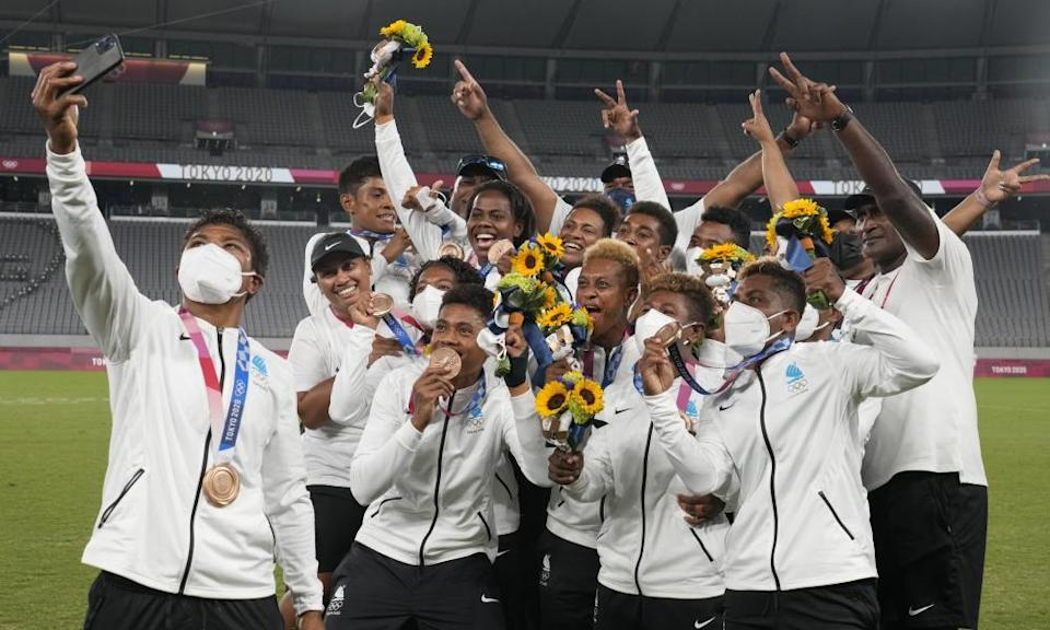 Fijiana, the women's rugby sevens team, celebrate with their bronze medals