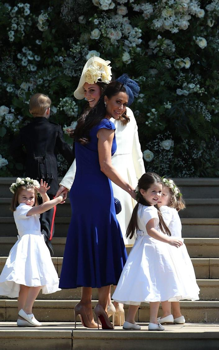 The Duchess of Cambridge with the bridesmaids  - Jane Barlow/ AFP