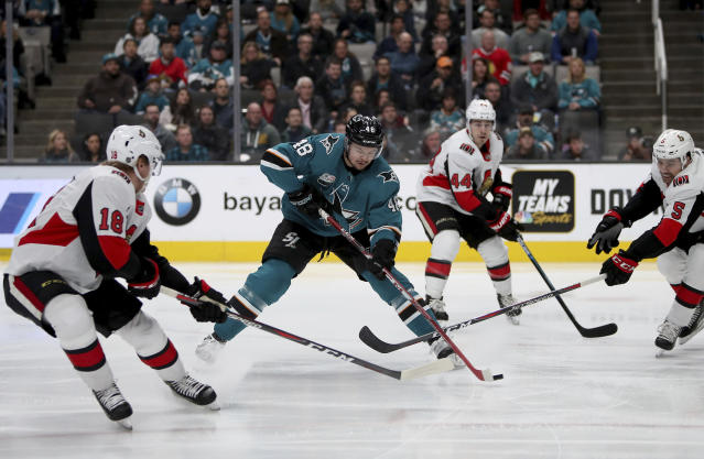 San Jose Sharks center Tomas Hertl (48) is pressured by the Ottawa Senators during the first period of an NHL hockey game in San Jose, Calif., Saturday, Jan. 12, 2019. (AP Photo/Scot Tucker)