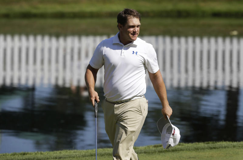 Daniel Summerhays smiles after making his putt on the 18th green during the third round of the John Deere Classic golf tournament at TPC Deere Run, Saturday, July 13, 2013, in Silvis, Ill. (AP Photo/Charlie Neibergall)