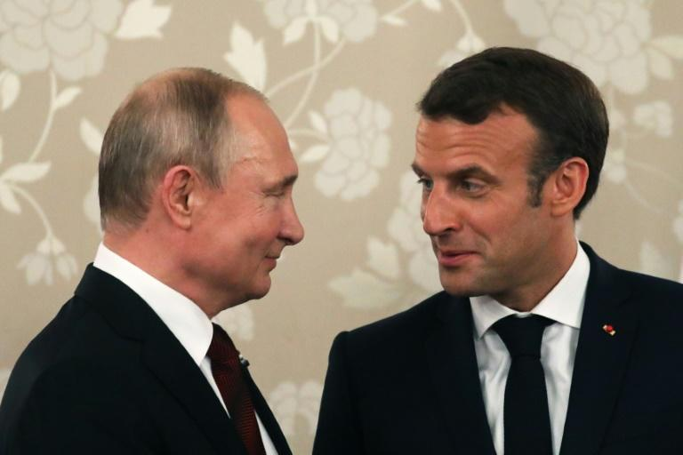 Macron (R) who hosted his Russian counterpart in grand style at the palace of Versailles in 2017, will this time meet Putin at his official holiday residence in Bregancon in southern France