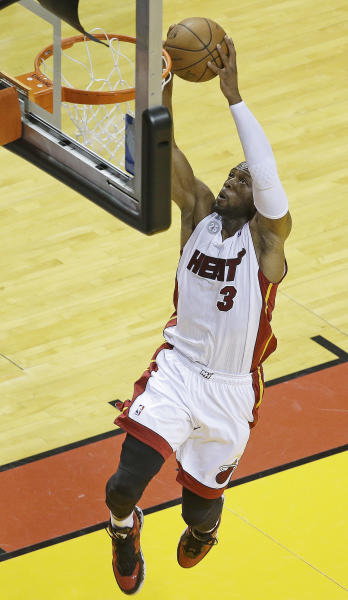 Miami Heat shooting guard Dwyane Wade (3) shoots against the Indiana Pacers during the first half of Game 7 in their NBA basketball Eastern Conference finals playoff series, Monday, June 3, 2013 in Miami. (AP Photo/Wilfredo Lee)