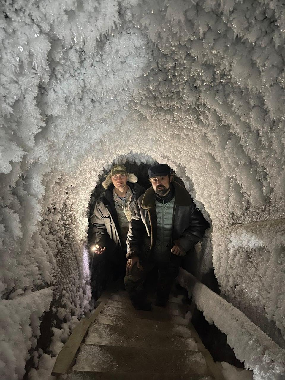 Nikita Zimov takes Evgeny Lebedev into an ice cave, tunnelling deep into the permafrost (Valentina Morriconi)
