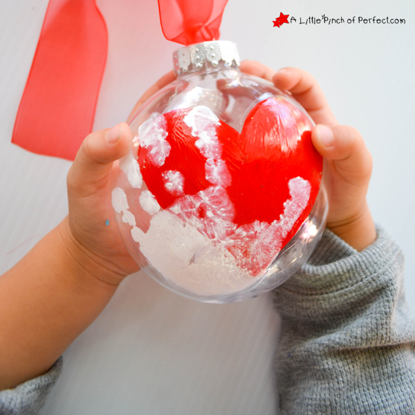 "<p>Use acrylic paint to apply your kid's handprint to a clear ball ornament; glass and plastic work equally well. Hang from your tree or fill with candies and give as gifts sure to be cherished long after the sweets are gone.</p><p><em><a href=""https://alittlepinchofperfect.com/handprint-keepsake-christmas-ornamen/"" rel=""nofollow noopener"" target=""_blank"" data-ylk=""slk:Get the tutorial at A Little Pinch of Perfect»"" class=""link rapid-noclick-resp"">Get the tutorial at A Little Pinch of Perfect»</a></em></p>"