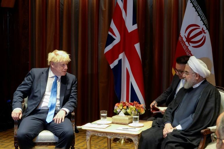 Iranian President Hassan Rouhani meets with British Prime Minister Boris Johnson on the sidelines of the UN General Assembly in September 2019 (AFP Photo/HO)