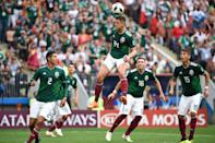 <p>Mexico's forward Javier Hernandez (C) heads the ball during the Russia 2018 World Cup Group F football match between Germany and Mexico at the Luzhniki Stadium in Moscow on June 17, 2018. (Photo by Kirill KUDRYAVTSEV / AFP) </p>