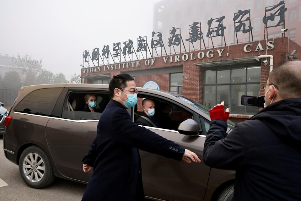 Peter Daszak and Thea Fischer, members of the World Health Organization (WHO) team tasked with investigating the origins of the coronavirus disease (COVID-19), sit in a car arriving at Wuhan Institute of Virology in Wuhan, Hubei province, China February 3, 2021. REUTERS/Thomas Peter     TPX IMAGES OF THE DAY