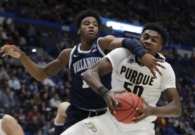 <p>Villanova's Saddiq Bey, left, defends against a drive by Purdue's Trevion Williams (50) during the first half of a second round men's college basketball game in the NCAA Tournament, Saturday, March 23, 2019, in Hartford, Conn. (AP Photo/Elise Amendola) </p>