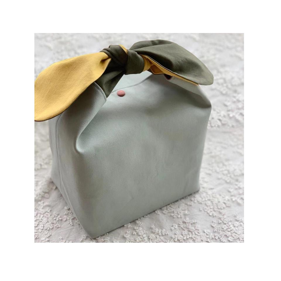 """These color-block bento bags are the perfect alternative to single-use plastics. Pack lunch in one or bring it to your next restaurant outing to use as a zero-waste takeout bag. $20, Etsy. <a href=""""https://www.etsy.com/listing/997026589/green-zero-waste-cotton-lunch-bag-multi"""" rel=""""nofollow noopener"""" target=""""_blank"""" data-ylk=""""slk:Get it now!"""" class=""""link rapid-noclick-resp"""">Get it now!</a>"""