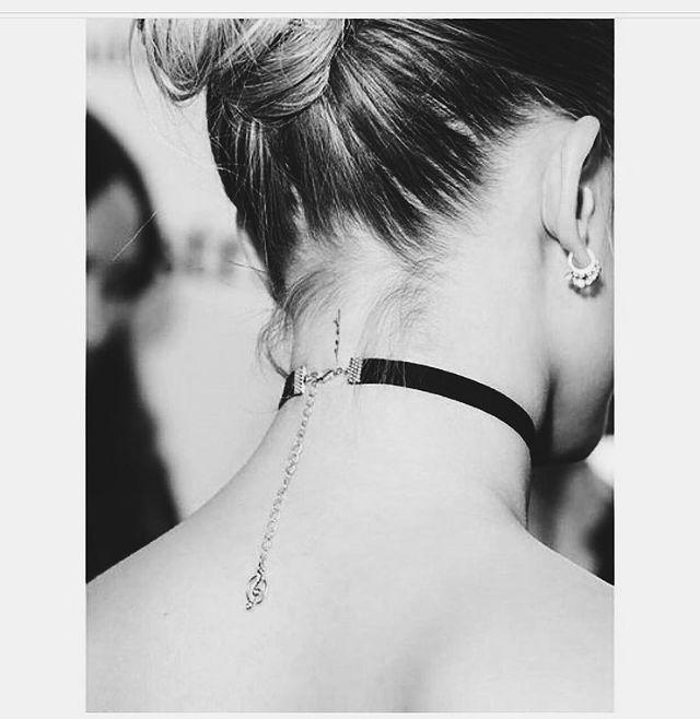 """<p>On the back of her neck, Bieber - who has spoken publicly about her devout Christian beliefs - has the word 'Seek' written, which she explained on Instagram is related to a bible verse. </p><p><a href=""""https://www.instagram.com/p/BKe2IQsgaHb/?utm_source=ig_embed"""" rel=""""nofollow noopener"""" target=""""_blank"""" data-ylk=""""slk:See the original post on Instagram"""" class=""""link rapid-noclick-resp"""">See the original post on Instagram</a></p>"""
