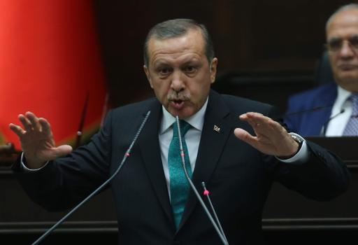 Turkey's Prime Minister Recep Tayyip Erdogan delivers a speech to the members of the Turkish Parliament in Ankara on January 14, 2014