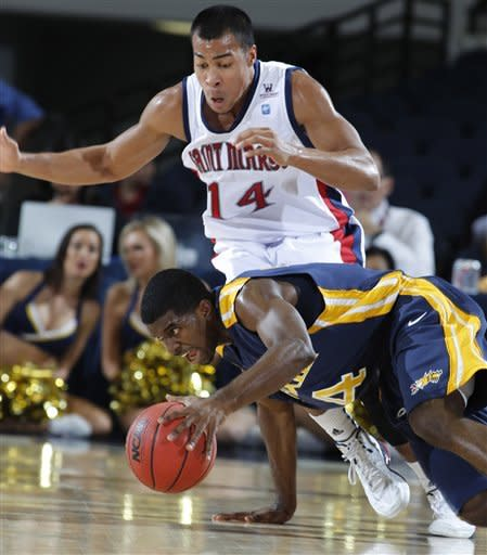 Drexel guard Frantz Massenat, below, loses his footing as he dribbles away from Saint Mary's guard Stephen Holt (14) during the first half of their NCAA college basketball game in the first round of the DirecTV Classic in Anaheim, Calif., Thursday, Nov. 22, 2012. (AP Photo/Alex Gallardo)