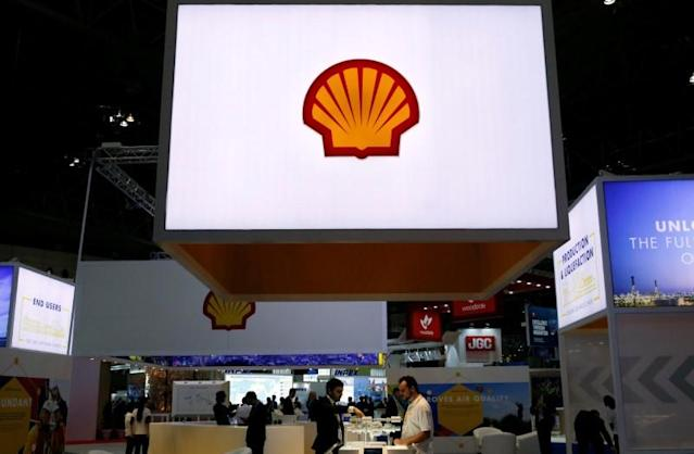 FILE PHOTO - Staff members work at the booth of Royal Dutch Shell at Gastech, the world's biggest expo for the gas industry, in Chiba, Japan, April 4, 2017. REUTERS/Toru Hanai